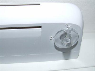 Verstellknopf für Automatikbetrieb (~) oder Verschluss (o) mit Grundlüftung
